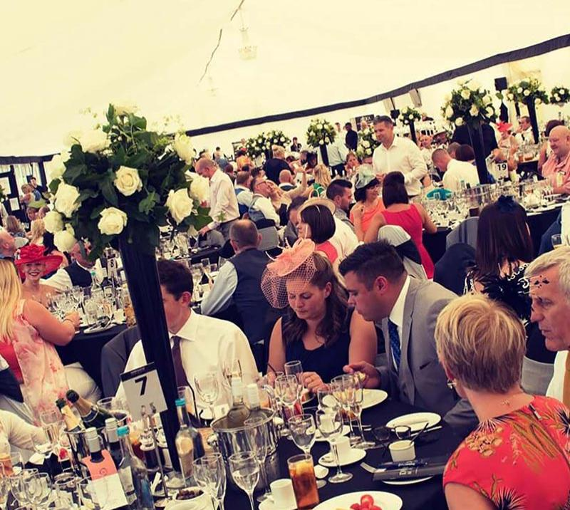 A crowd enjoying an afternoon party dining experience at Newcastle Racecourse