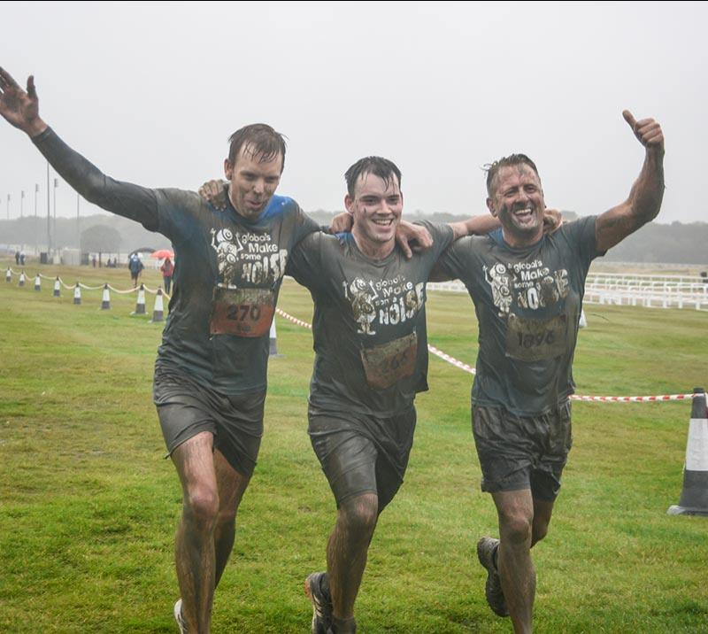 A team of three men celebrate success at Newcastle Stampede hosted at Newcastle Racecourse