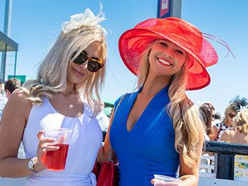 Two dressed up ladies at the races at Newcastle Racecourse.