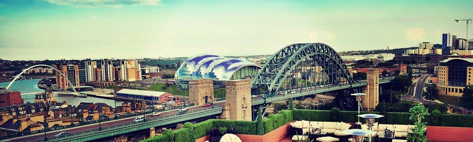 Panoramic view of the Newcastle town featuring the Tyne bridge.