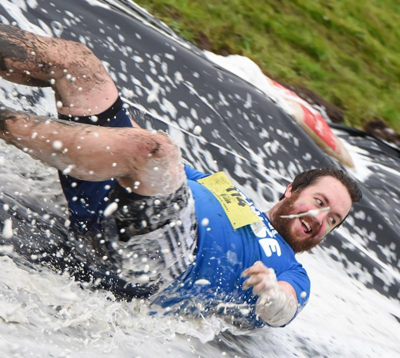 A man sliding on a obstacle at the Stampede at Newcastle Racecourse.