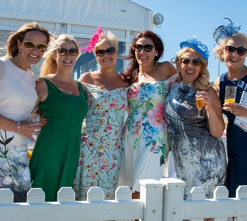 Ladies enjoying a drink in the sun at Newcastle Racecourse